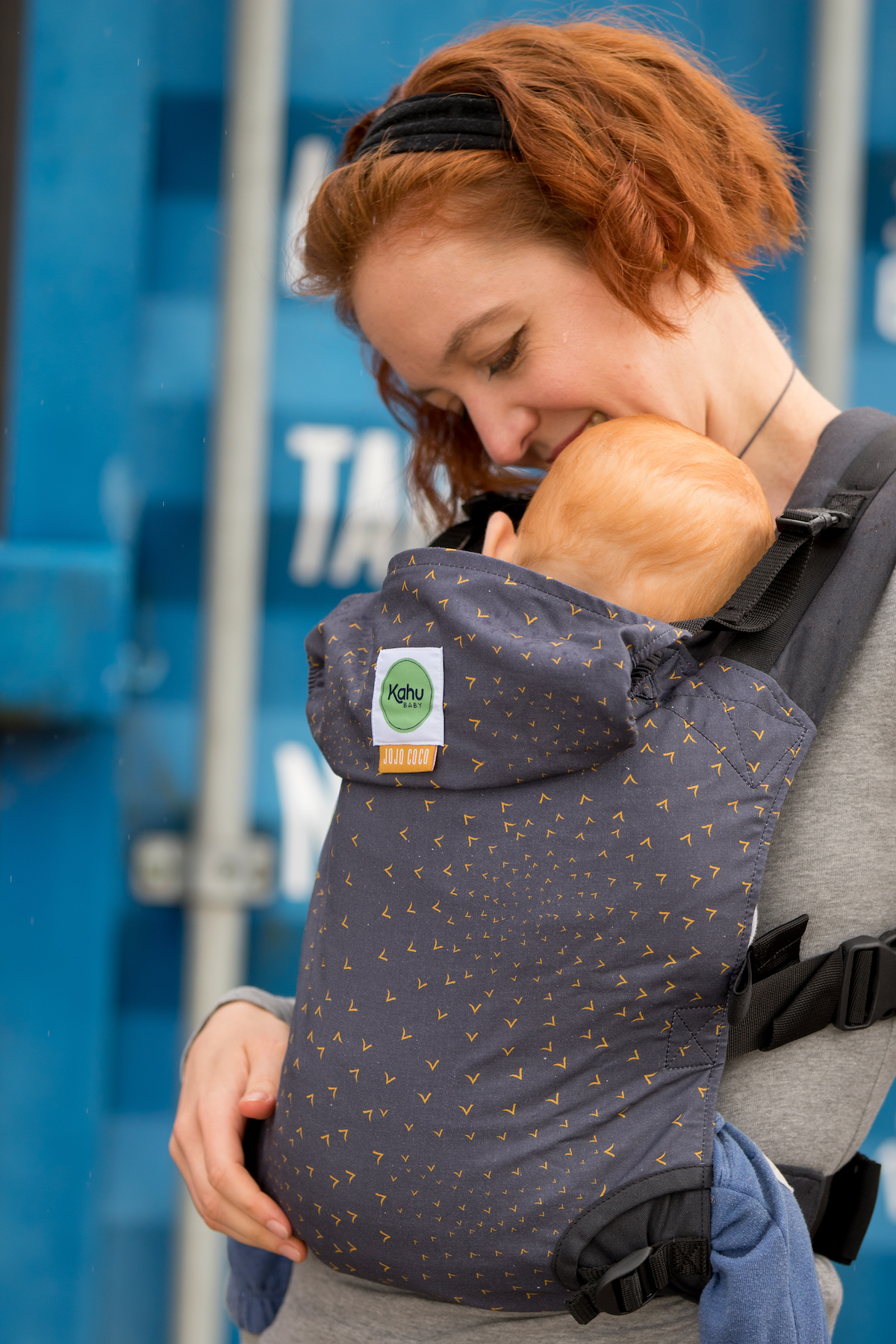 KahuBaby Carrier being used for a front carry. Featured print is Charcoal Flocking Birds.