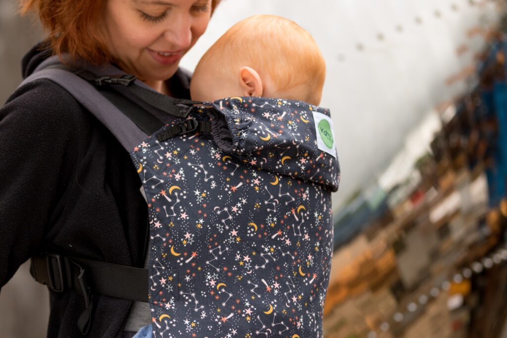 KahuBaby carrier with older baby in Under The Stars print.